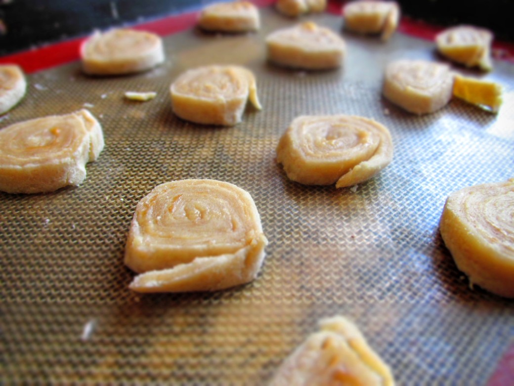 berry swirl pie cookies on baking sheet