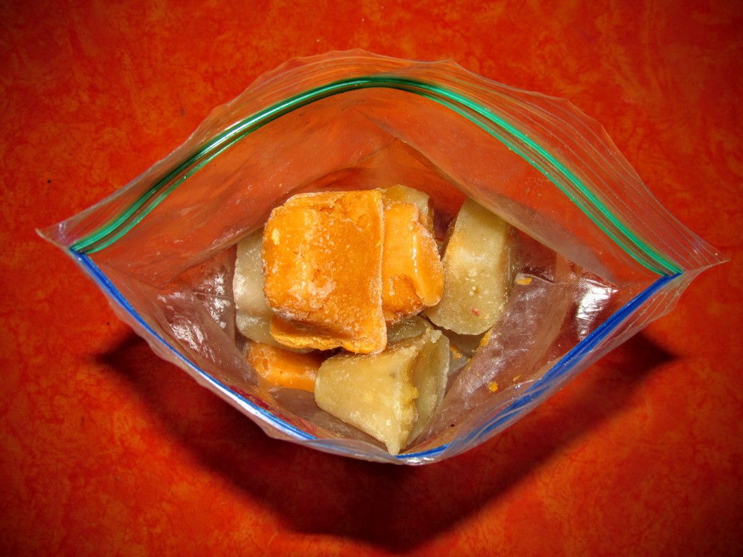 homemade baby food frozen into cubes stored in a bag for easy freezing