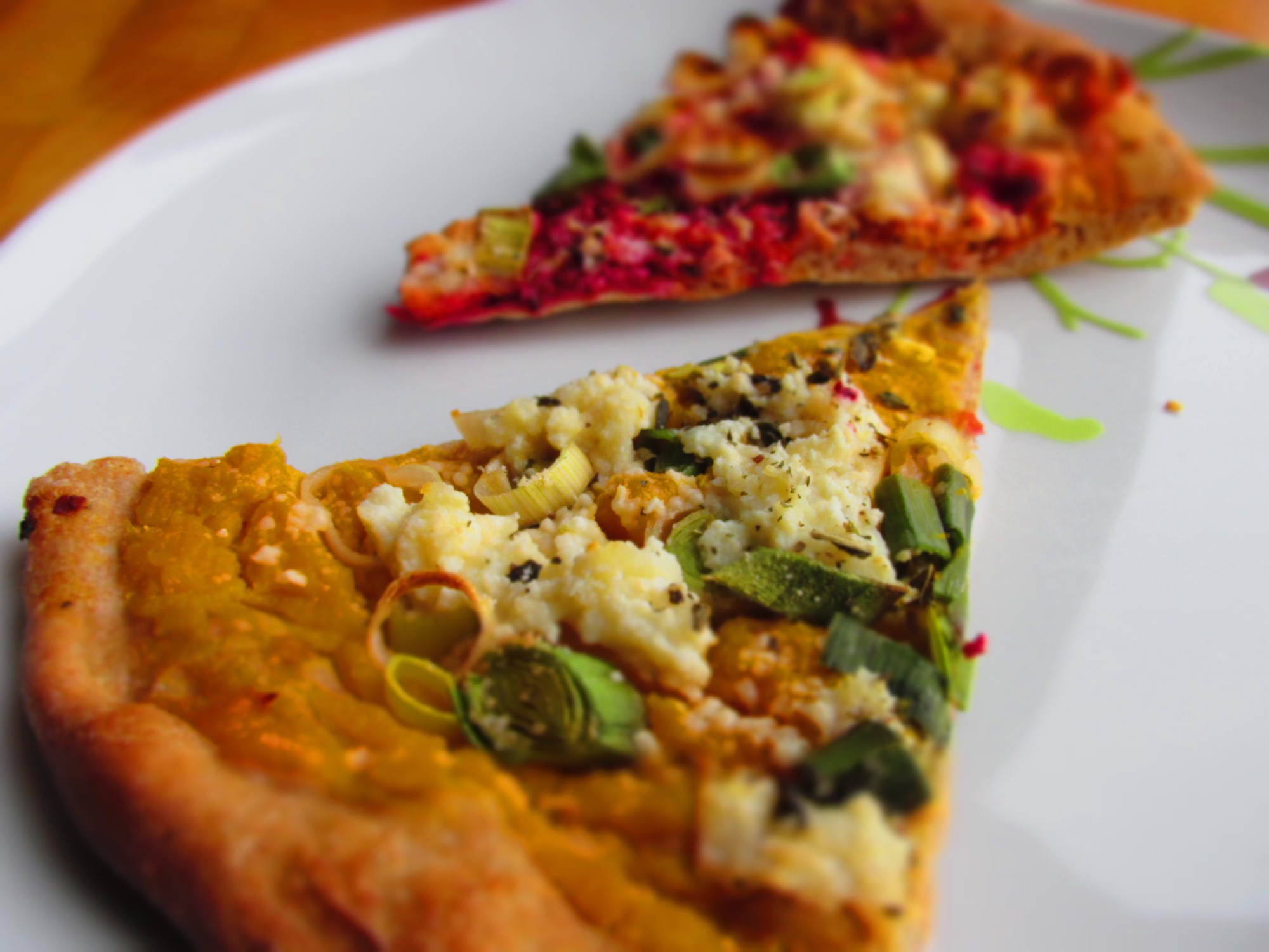 pizza slices with squash, beets, carrots, and more snuck into the sauce