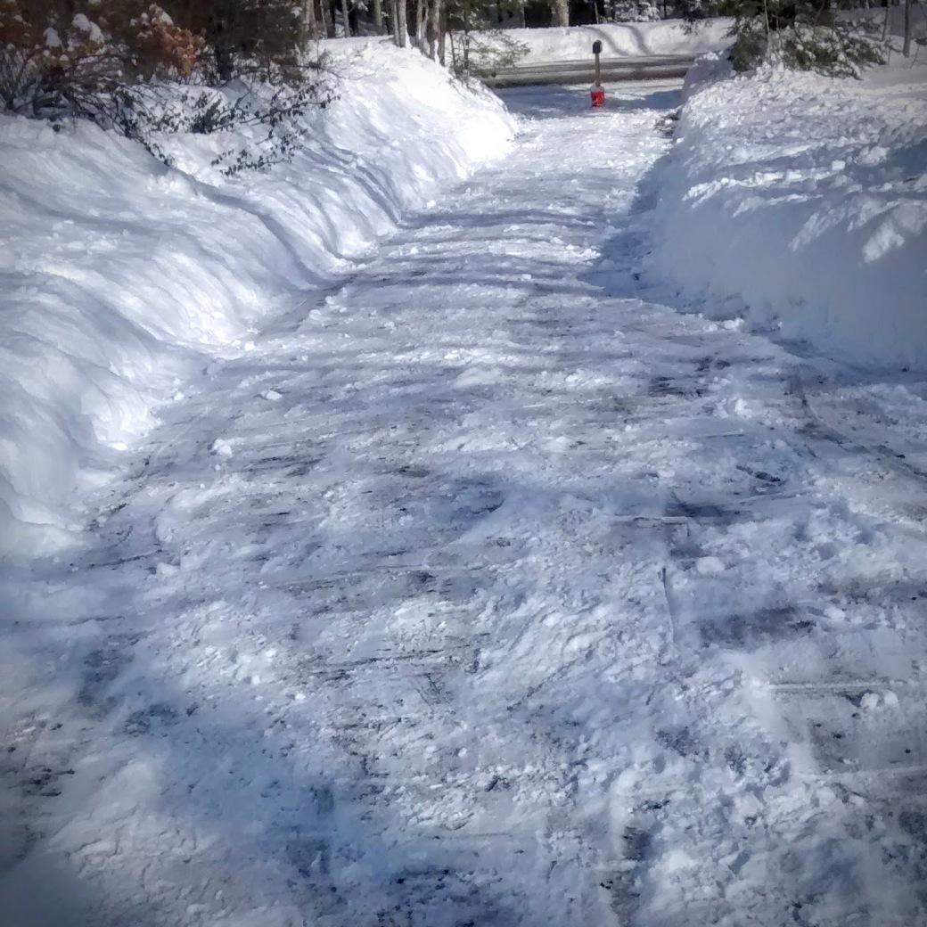 A fully shoveled driveay