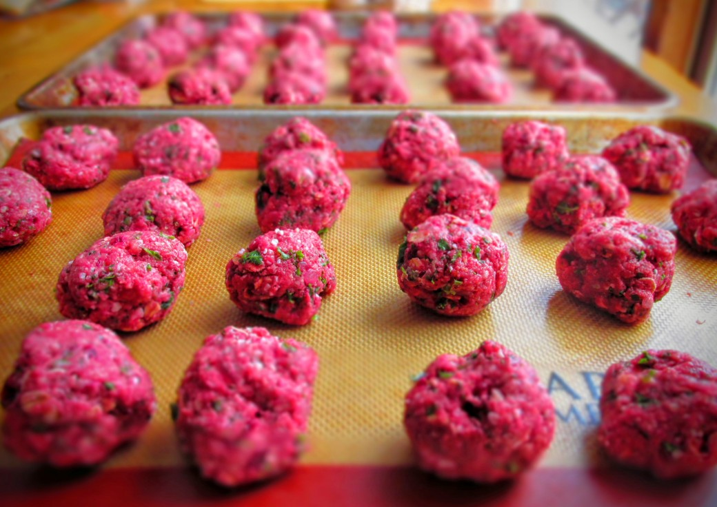 rolling out healthy meatballs with kale rutabaga beets and oats