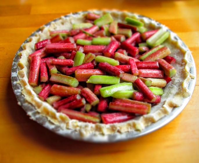 assembling a rhubarb pie